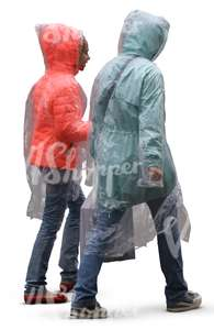 mother and daughter in rainjackets walking in the rain