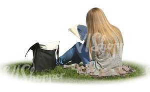 woman sitting on the grass and reading