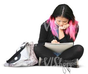 asian woman sitting and writing in her notebook