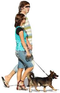 cut out couple walking a dog