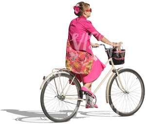 woman dressed in pink riding a bike