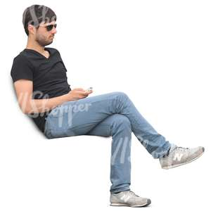 man sitting with a phone in his hand