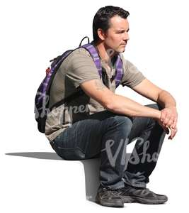 man with a backpack sitting