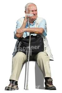 older man with a crutch sitting