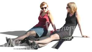 two women sitting with streched out legs