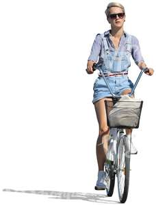 woman in denim shorts riding a bike