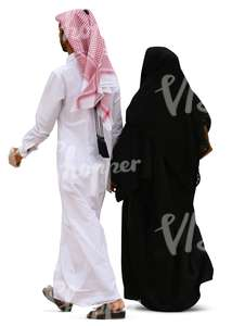 arab man and woman walking hand in hand