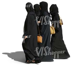 four arab women in abayas walking