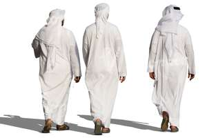 three arab men in white thobes walking
