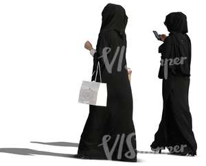 two muslim women with shopping bags