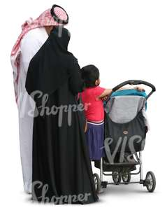 muslim family standing by a baby stroller