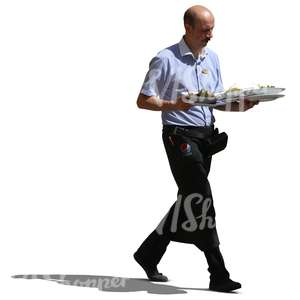waiter walking and carrying plates