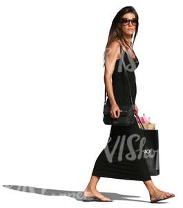 woman in a black dress and shopping bags