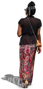 african woman in a long skirt walking