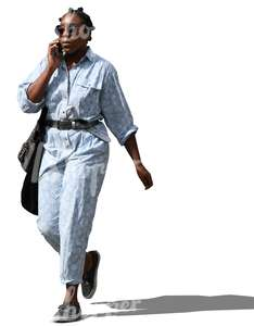 black woman walking and talking on the phone