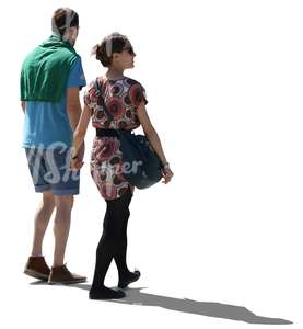 cut out backlit couple walking hand in hand