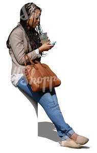 cut out black woman sitting and drinking juice