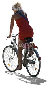 cut out backlit woman riding a bike