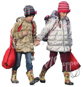 two young girls in autumn coats walking hand in hand
