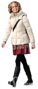 smiling woman in a white puffy coat walking