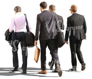four cut out businessmen walking