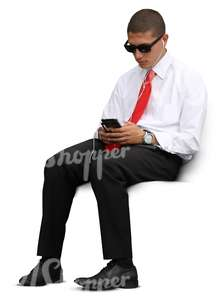 cut out businessman sitting and looking at his phone