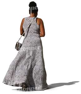 black woman in a long dress walking
