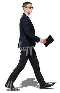 cut out businessman with a black suit walking
