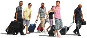 group of people with suitcases walking