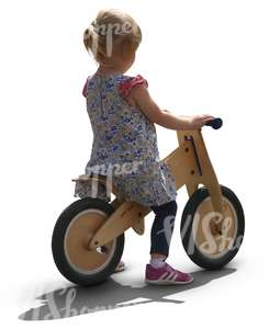 young girl riding a likeabike