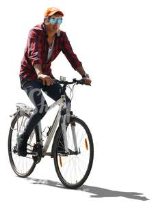 backlit young man riding a bike