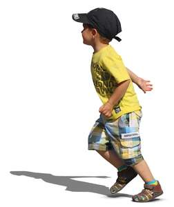 young boy in a yellow t-shirt running