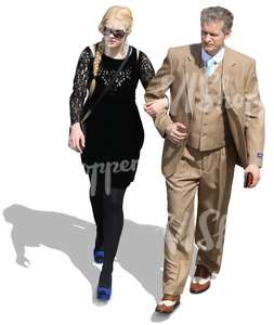 couple in formal clothing walking