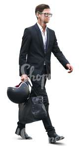 young businessman walking with a helmet and bag in his hand