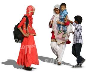 two hindu women with two boys walking