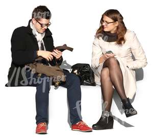 man and woman wearing autumn coats sitting and talking