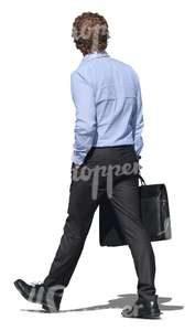 cut out businessman walking with a briefcase in his hand