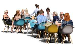 group of people sittnin in a street cafe in summertime