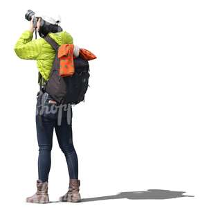 asian woman with a backpack taking a picture
