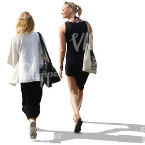 two women with blond hair walking and talking