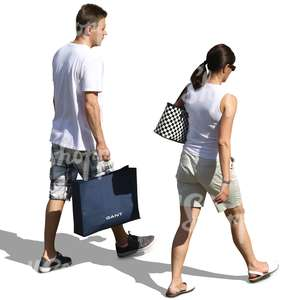 man and woman in light summer clothing walking