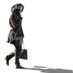 woman in a black hooded coat walking