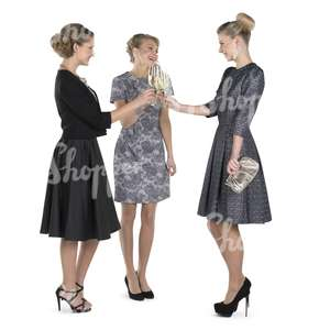 three women in fancy party dress drinking champagne