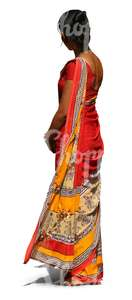 Indian woman wearing a colorful red sari standing