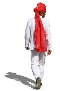 hindu man with a red turban and wearing a white suit walking