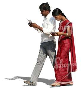 indian man and woman walking and reading something