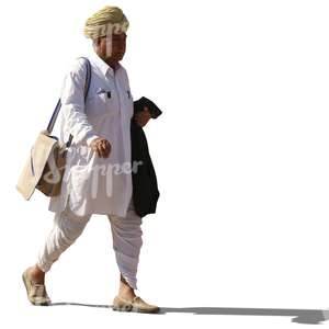 hindu man with a turban wearing ethnical indian attire walking