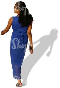 woman in a blue dress walking
