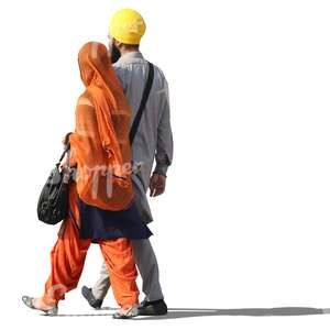 indian couple in traditional attire walking together