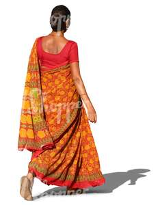 indian woman in a traditional orange sari walking